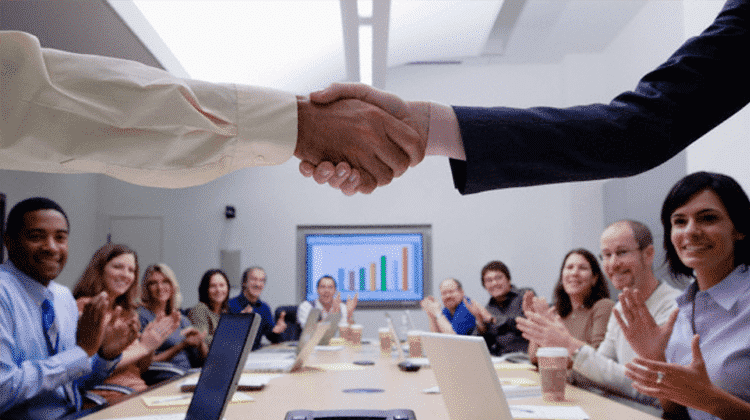 How to Use PPC to Get More Sales - handshake - Disruptive Advertising
